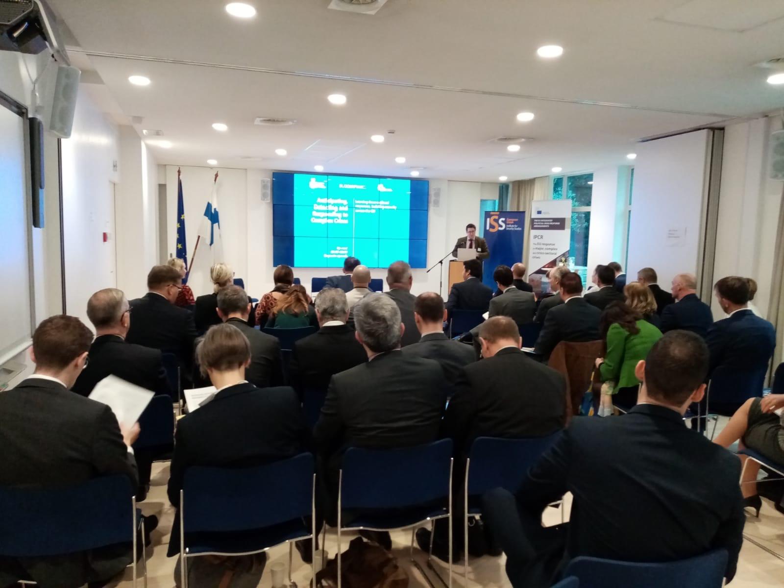 Daniel Fiott opens event in meeting room