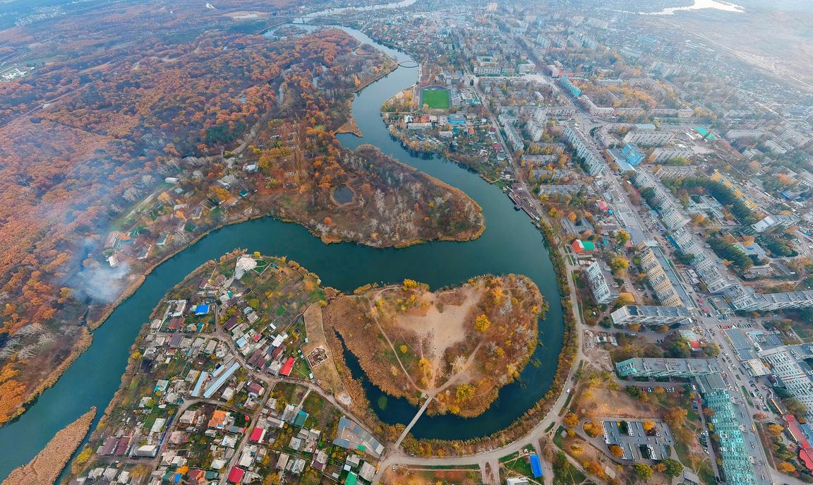 Aerial view of river in eastern Ukraine dividing city from coutryside
