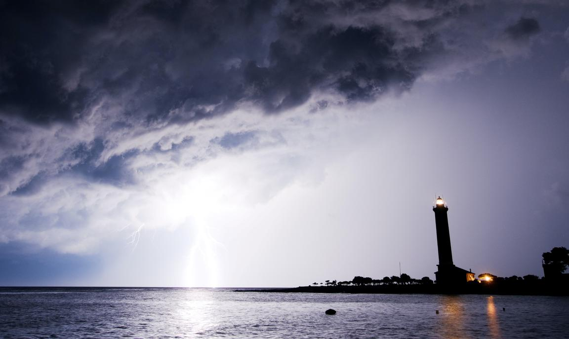 Lighthouse and lighting storm