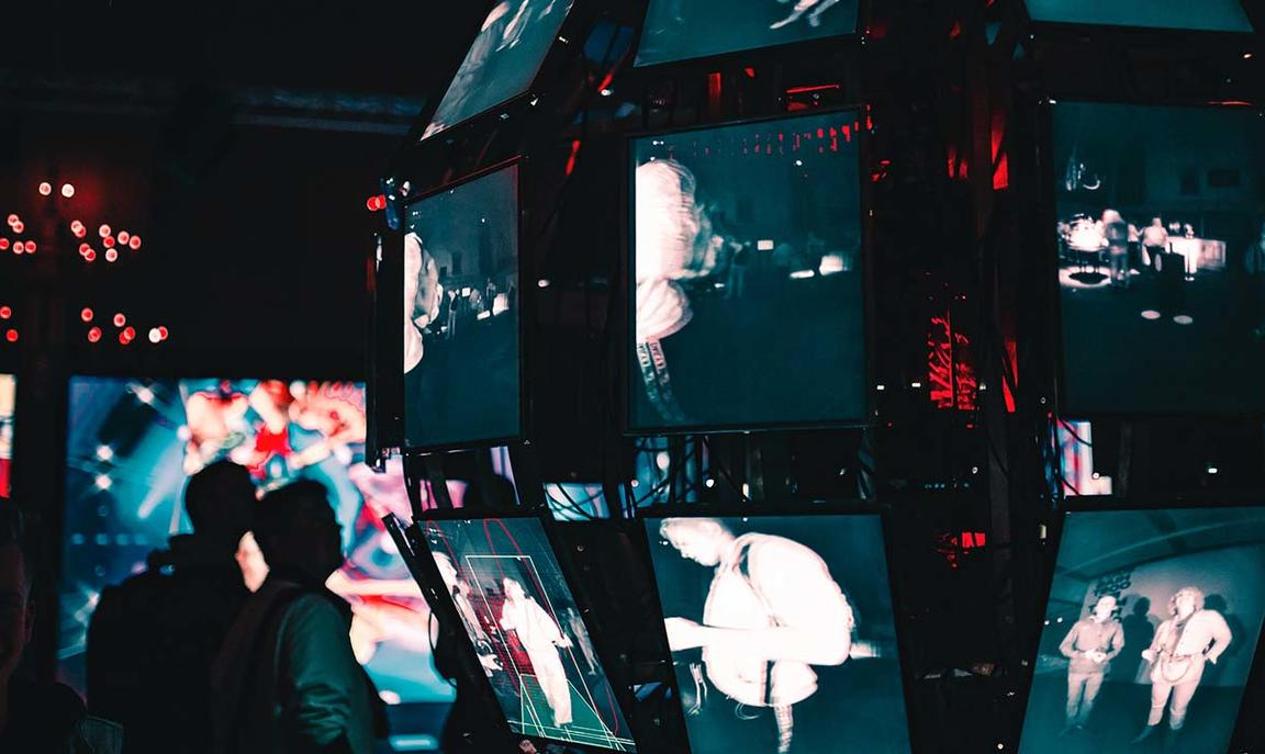 Image of people looking at multiple screen