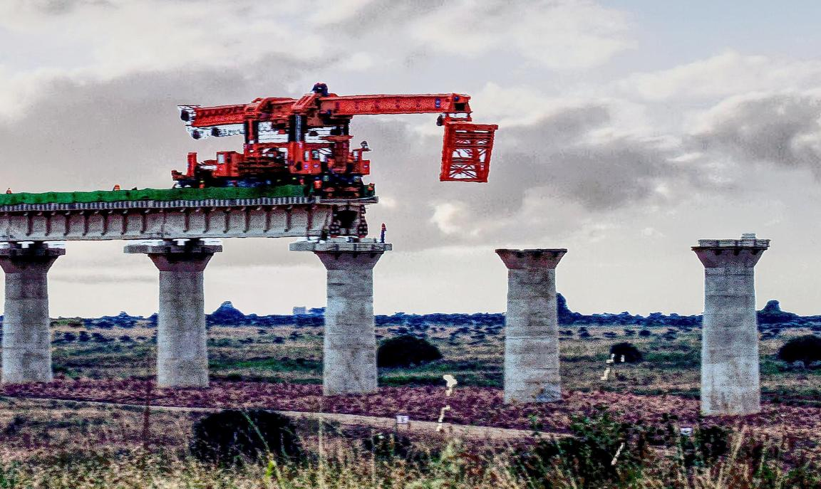Digger on bridge